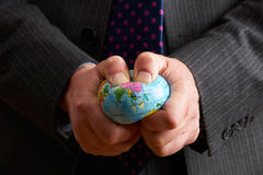 Affärsman Squeezing Globe Over Asien Royaltyfri Bild