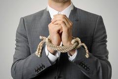 Affärsman With Tied Hands Fotografering för Bildbyråer