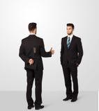 Affärsman två skakar händer Arkivbilder