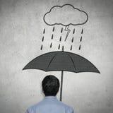 Affärsman under paraplyet Royaltyfria Bilder