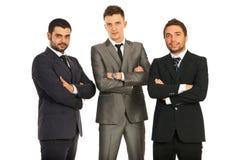Affärsmanar med räcker korsat Fotografering för Bildbyråer