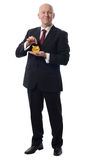 Affärsmandroppspund i guld- pig Arkivbild