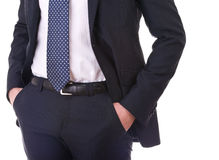 Affärsmannen räcker stoppa i fickan in. Royaltyfri Fotografi