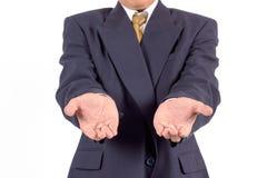 Affärsmanhänder som, om rymma något. Fokus på fingerspetsar Royaltyfria Foton