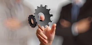 Affärsmanhand som visar kugghjulet 3d till framgång Arkivbilder