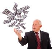 affärsmanholdingpengar Arkivbild