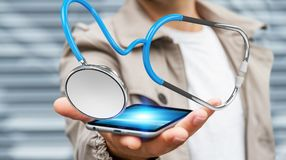 Affärsmaninnehav och trycka på sväva renderi för stetoskop 3D Royaltyfria Bilder