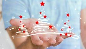 Affärsmaninnehavet och rörande julträd skissar Royaltyfri Foto