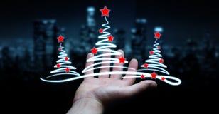 Affärsmaninnehavet och rörande julträd skissar Arkivfoto