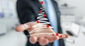 Affärsmaninnehavet och rörande julträd skissar Royaltyfri Fotografi