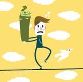 Affärsmannen är den hållande sedeln och att balansera på ett rep Arkivbilder