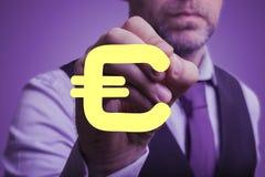Affärsmannen drar euro Fotografering för Bildbyråer
