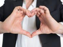 Affärsmannen gör hjärta att forma med hans hand Royaltyfri Bild