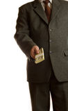affärsmannen ger pengar royaltyfria foton