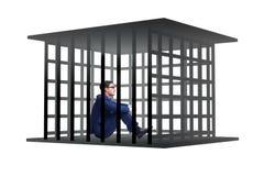 Affärsmannen i buren som isoleras på vit Arkivfoton