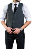 Affärsmannen i en vit skjorta rymmer hans händer på bältet arkivfoton