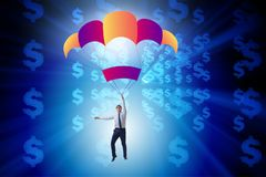 Affärsmannen i guld- hoppa fallskärm begrepp Arkivbild