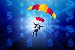 Affärsmannen i guld- hoppa fallskärm begrepp Fotografering för Bildbyråer