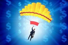 Affärsmannen i guld- hoppa fallskärm begrepp Royaltyfri Fotografi