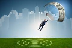 Affärsmannen i guld- hoppa fallskärm begrepp Arkivfoto