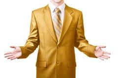 Affärsmannen i guld- passar Royaltyfri Bild