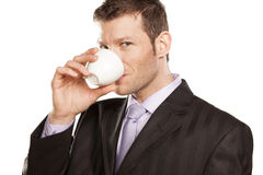 Affärsmannen med kaffe kuper Arkivfoto