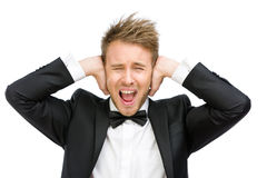 Affärsmannen med stängda ögon stänger hans öron Royaltyfria Foton