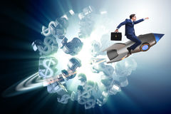 Affärsmannen på raketflyg runt om dollar Royaltyfria Foton