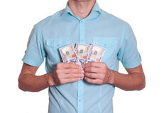 Affärsmannen rymmer lotten av pengar Royaltyfri Fotografi