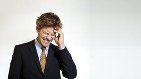 Affärsmannen smärtar in från huvudvärk Royaltyfria Bilder