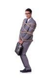 Affärsmannen som binds upp med repet som isoleras på vit arkivbilder