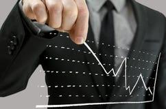 Affärsman som uppåt drar grafen Fotografering för Bildbyråer