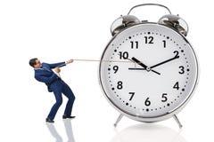 Affärsmannen som drar klockan i tidbegrepp royaltyfri bild