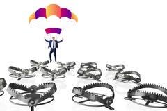 Affärsmannen som faller in i fälla hoppa fallskärm på Royaltyfri Foto