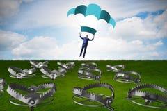 Affärsmannen som faller in i fälla hoppa fallskärm på Arkivfoto