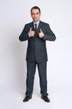 Affärsmannen som gör tummarna gör en gest upp arkivfoto