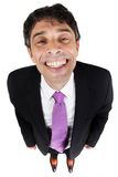 Affärsmannen som ger ett ostliknande, grinar royaltyfri bild