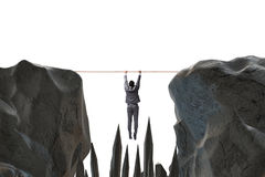 Affärsmannen som hänger på rep i farabegrepp fotografering för bildbyråer