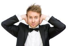 Affärsmannen stänger hans öron royaltyfria bilder