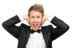 Affärsmannen stänger hans öron och skrin Arkivfoto