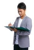Affärsmannen tar anmärkningen på skrivplattan Fotografering för Bildbyråer