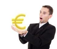 affärsmannen väljer det guld- tecknet för euroen Fotografering för Bildbyråer