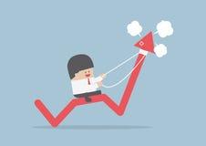 Affärsmanridning på ilsken aktiemarknadgraf Arkivfoton