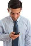 affärsmansms som texting royaltyfri fotografi