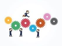 Affärsmanspring på kugghjulet Arkivfoto