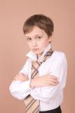 affärsmanståendebarn royaltyfria bilder