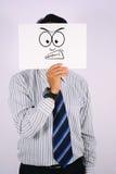 AffärsmanWearing Angry Face maskering Arkivfoto