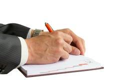Affärsmanwriting i anteckningsbok Fotografering för Bildbyråer