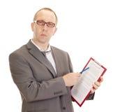 Affärsperson med clipboarden Fotografering för Bildbyråer