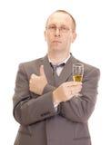 Affärsperson som dricker ett exponeringsglas av champagne Arkivbilder